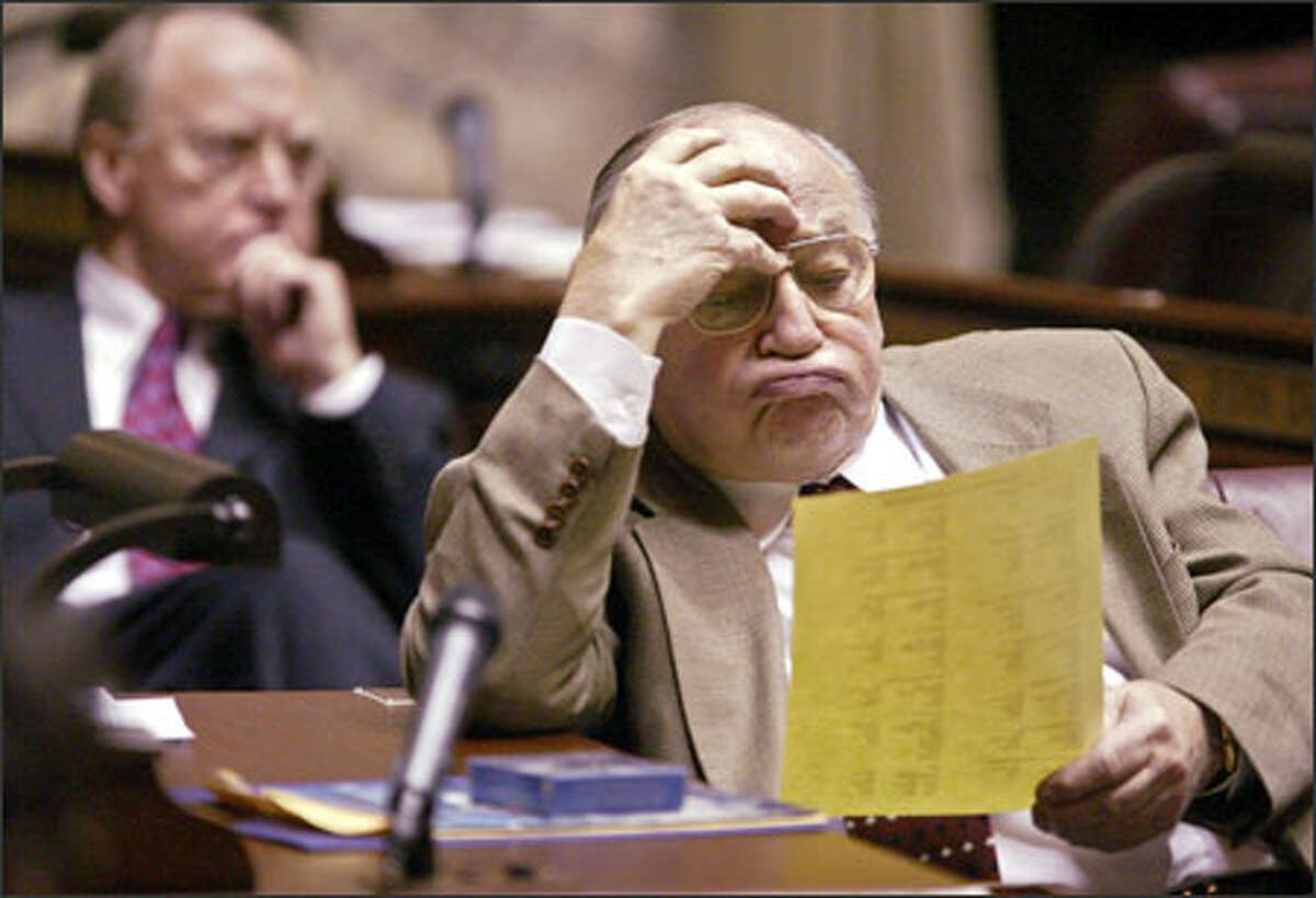 Sen. Bob McCaslin, R-Spokane Valley, looks over some paperwork during the opening of the 2005 legislative session in Olympia. Lawmakers met in the Capitol for the first time in more than two years. The building had been closed for renovation.