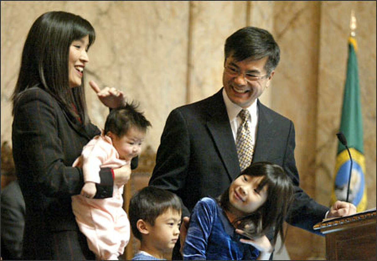 Gov. Gary Locke says goodbye at the state House in Olympia with his family: wife Mona Lee; new daughter Madeline; son Dylan; and other daughter Emily. Locke's term as governor ends Wednesday at noon.
