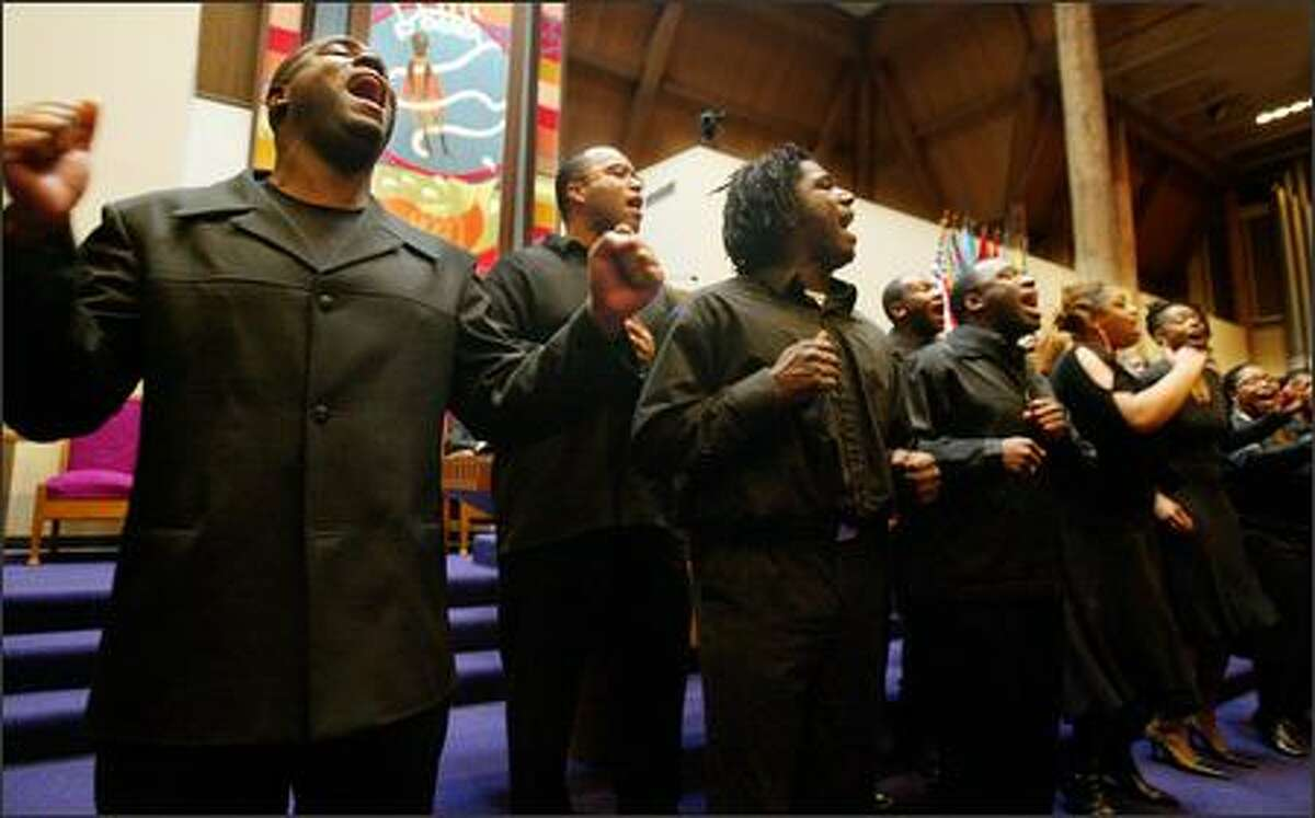 DaNell Daymon and Royalty, a Seattle area gospel choir, opened Seattle Community Colleges's 33rd Annual Martin Luther King, Jr. Community Celebration at Mt. Zion Baptist Church with a rousing performance. From left are Kenneth Mahoney II, Michael Thomas and Jerry Dawson.