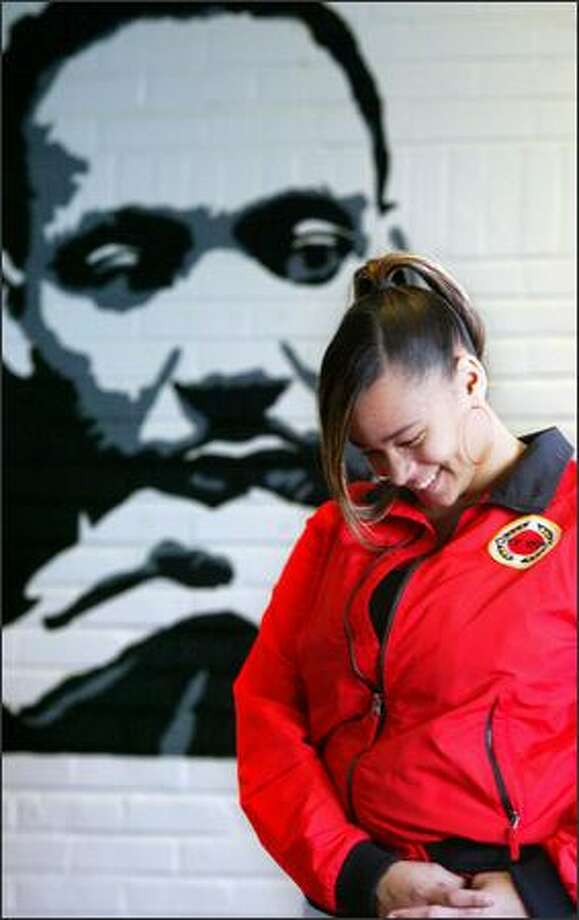 Leasha Donald-McNary, 15, a Center High sophomore, spent the past week teaching children about the civil rights movement. The mural behind her was painted by a member of City Year last summer at Meany Middle School. Photo: Karen Ducey, Seattle Post-Intelligencer / Seattle Post-Intelligencer