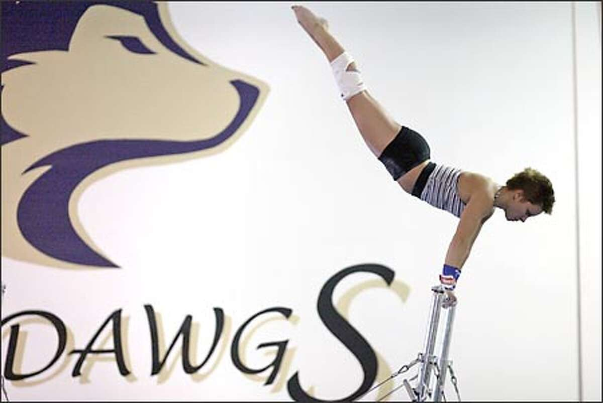 University of Washington gymnast Molly Seaman works out on the uneven parallel bars during practice. Seaman continues to recover from a troublesome knee injury that has required five surgeries -- the last one just two weeks ago.