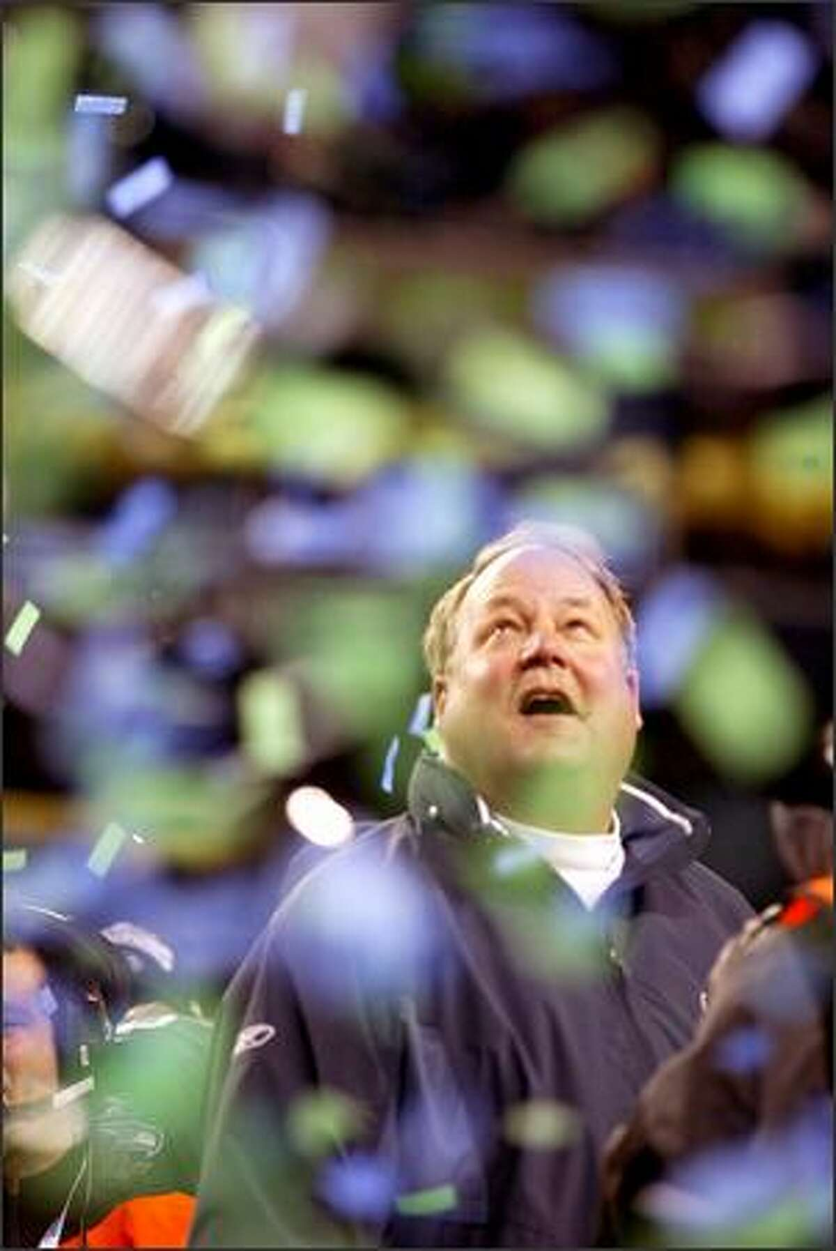 Coach Mike Holmgren watches as confetti falls during the trophy presentation ceremony after the Seahawks won the NFC Championship.