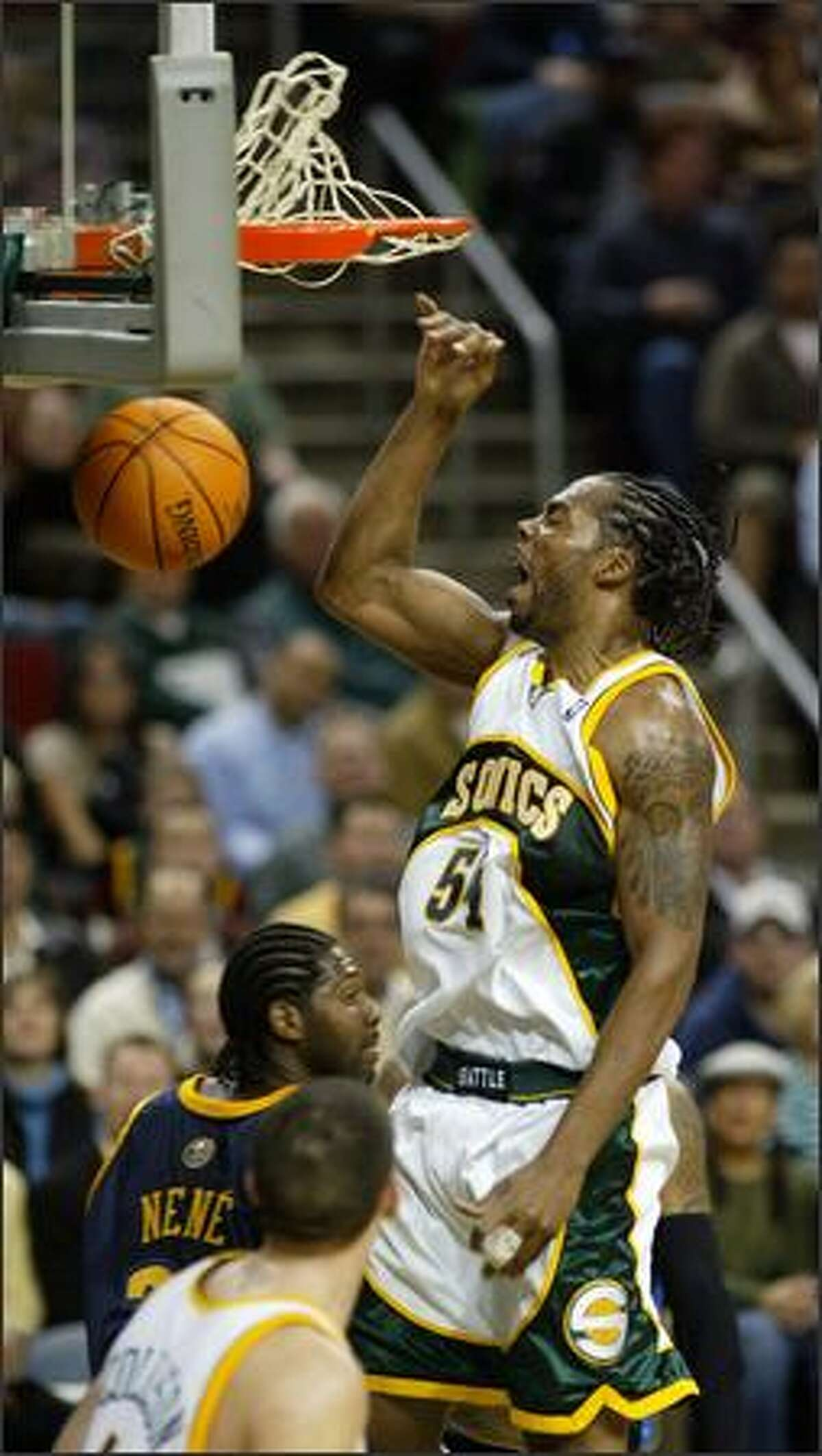 Supersonics Chris Wilcox throws it down against the Denver Nuggets for two of his 19 first half points at Key Arena in Seattle Tuesday.