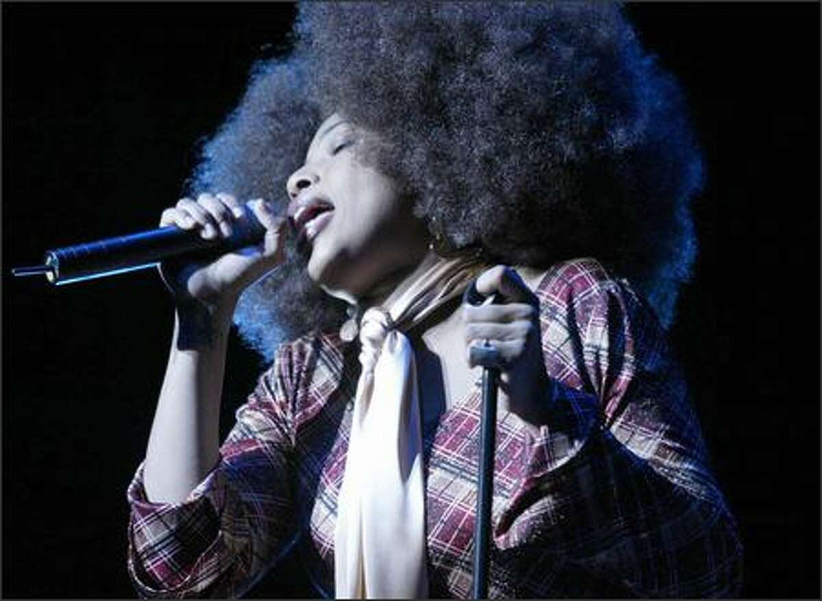 Macy Gray opens for David Bowie during a show at the Paramount Theater in Seattle.