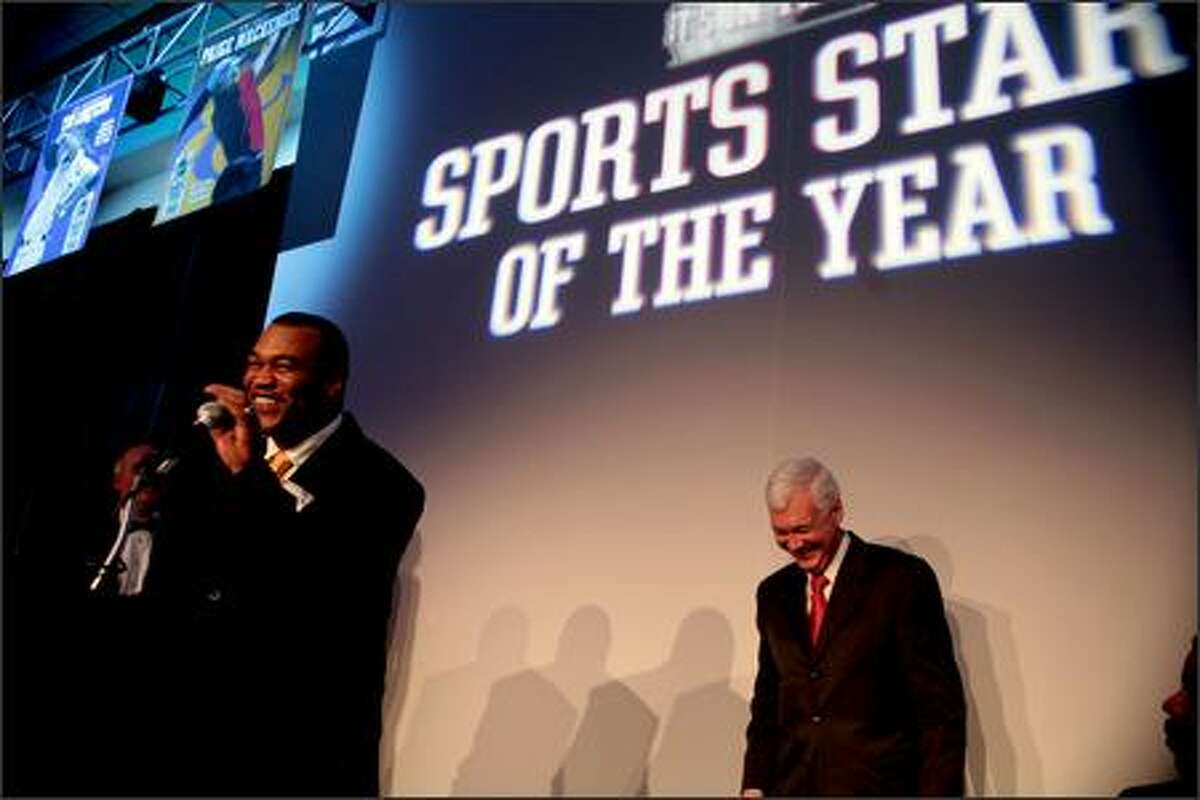 Tony Roy, nervous while accepting the male Sports Star of the Year award for his son, Brandon Roy, thanked the Seattle Times by accident, instead of the Seatle P-I, for the award. In the background, P-I publisher Roger Ogelsby laughs at the mistake.