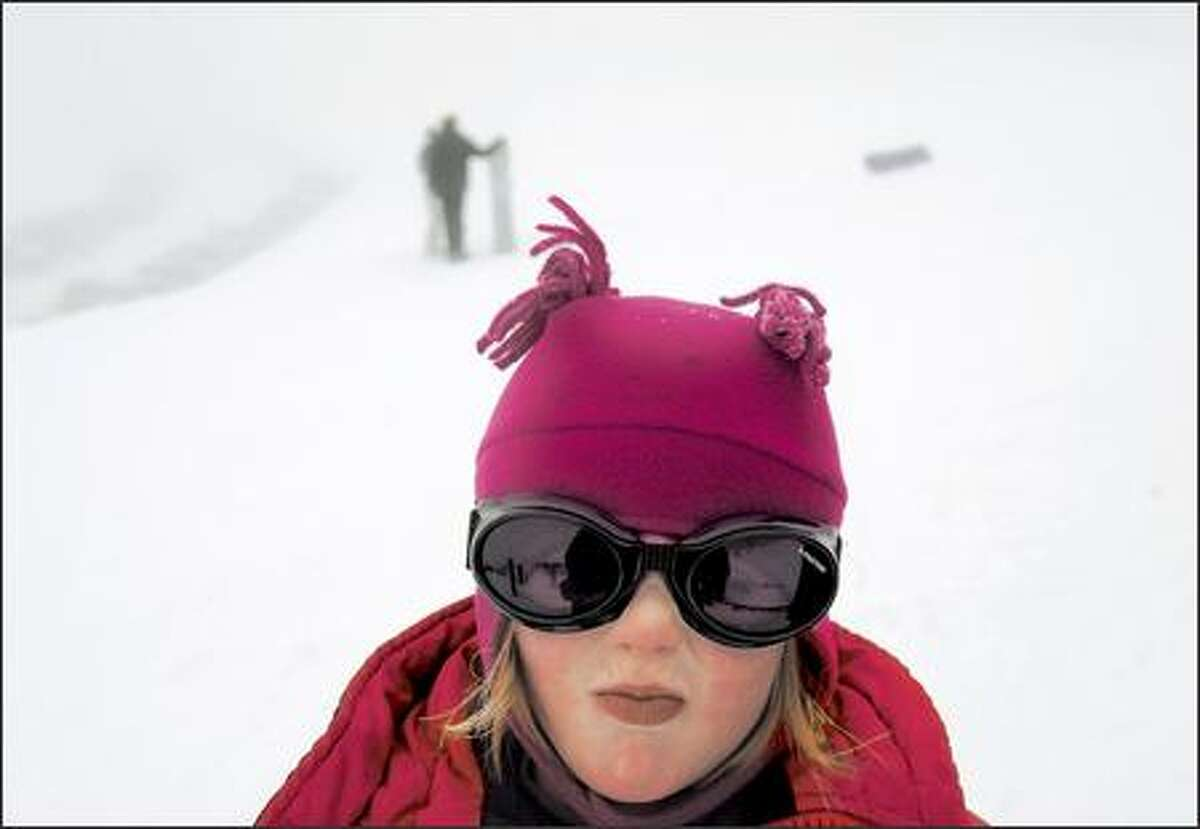 Mira Hitchcock, 5, is bundled against the cold during a ski lesson at Hurricane Ridge in Olympic National Park.