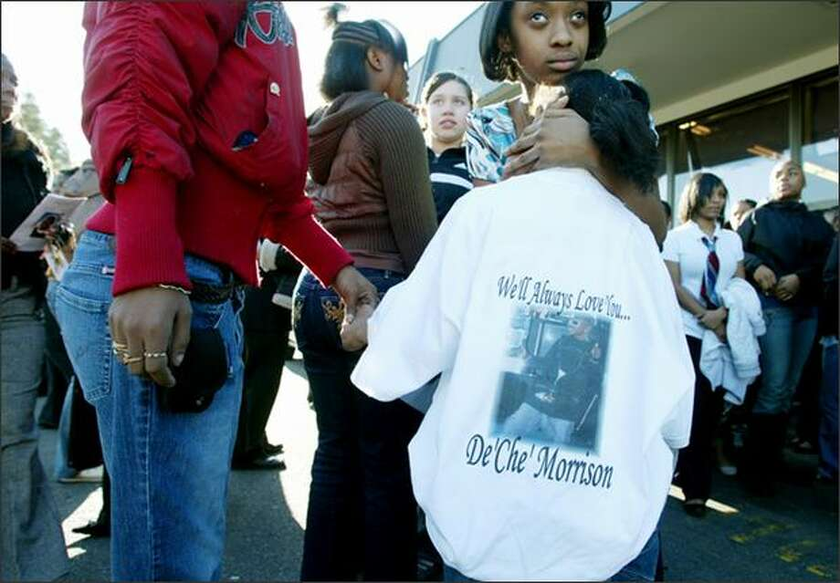 Jamazia Brown, 8, wearing a shirt in honor of her cousin Deche Morrison, 14, at Morrison's funeral at the Freedom Missionary Church in West Seattle. Holding Jamazia's hand is her step-mother Jimmia Brown. Photo: Paul Joseph Brown, Seattle Post-Intelligencer / Seattle Post-Intelligencer
