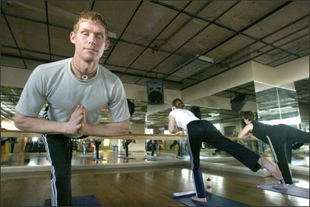 Travis Boothe teaches a Power Yoga class at Allstar Fitness in Seattle.