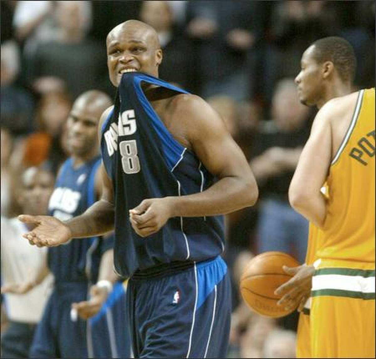 Dallas forward Antoine Walker grimaces after committing a foul in the fourth quarter.