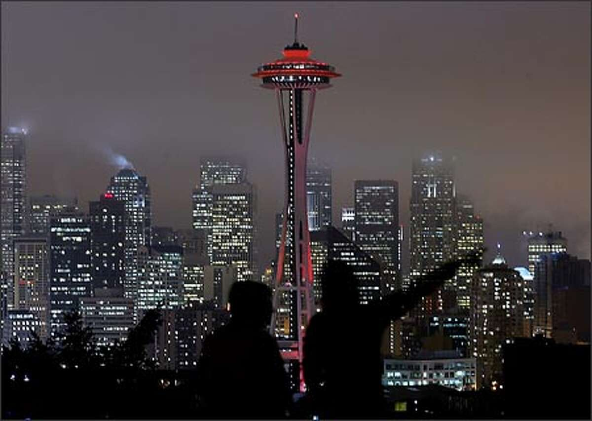 The Space Needle is bathed in red light Thursday night to kick off Friday's National Wear Red for Women Day. The designation is aimed at raising awareness of cardiovascular diseases, the No. 1 killer of women. Among other iconic structures