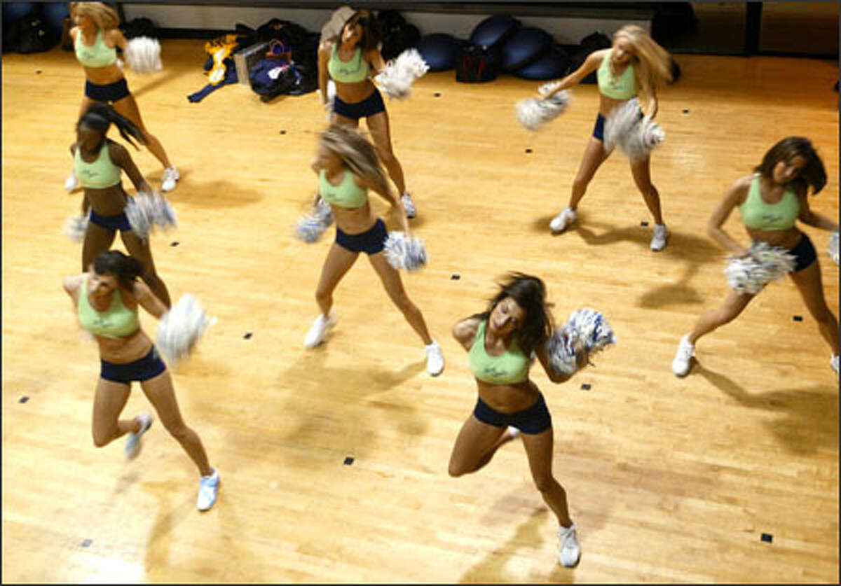 Members of the Sea Gals cheerleading squad practice at a Bellevue gym on Tuesday before heading to Detroit to perform at the Super Bowl.