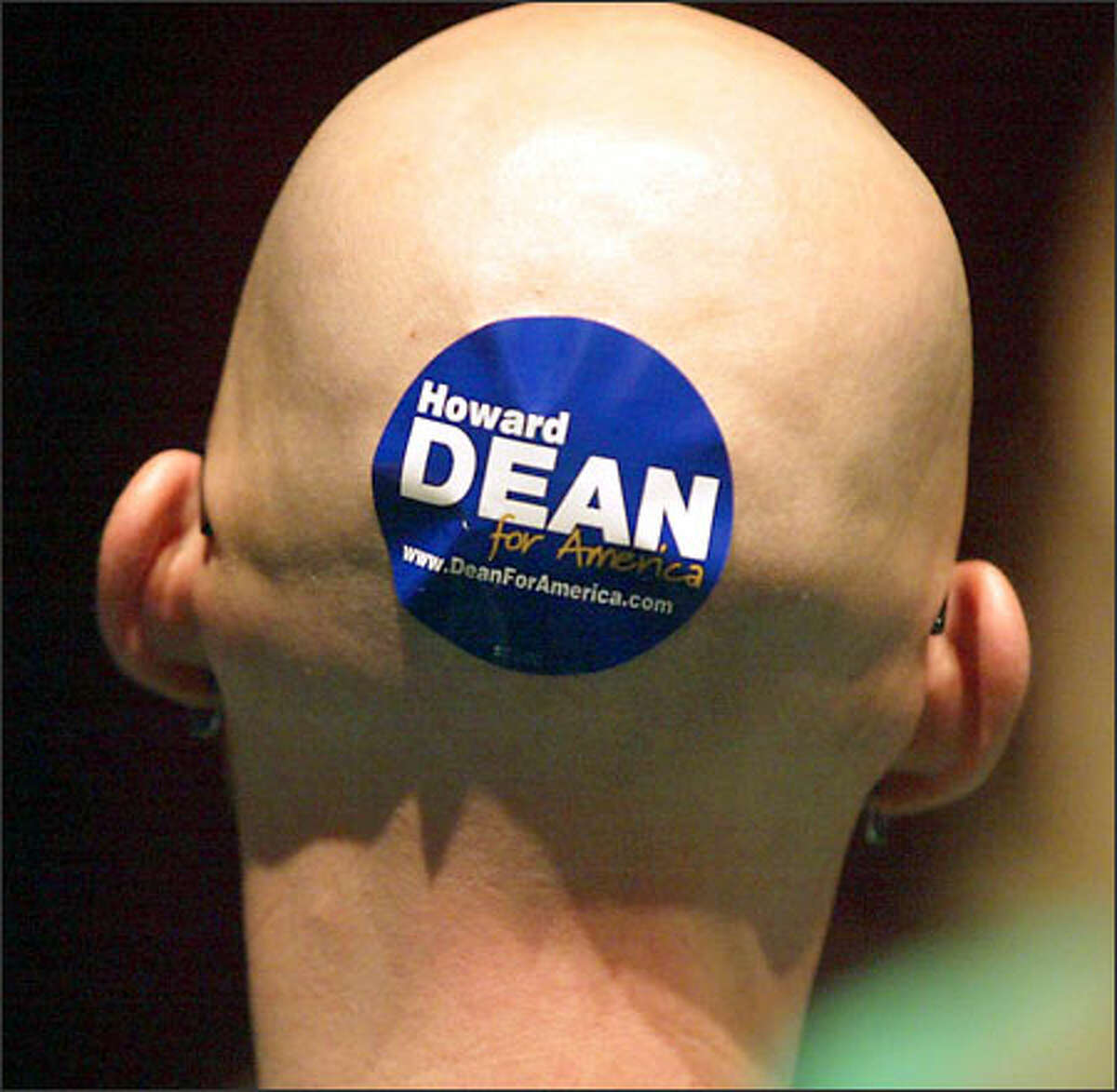Tim Gates of Olympia sports a Dean sticker on the back of his head. Gates later shook hands with Dean after Dean spoke in Tacoma.