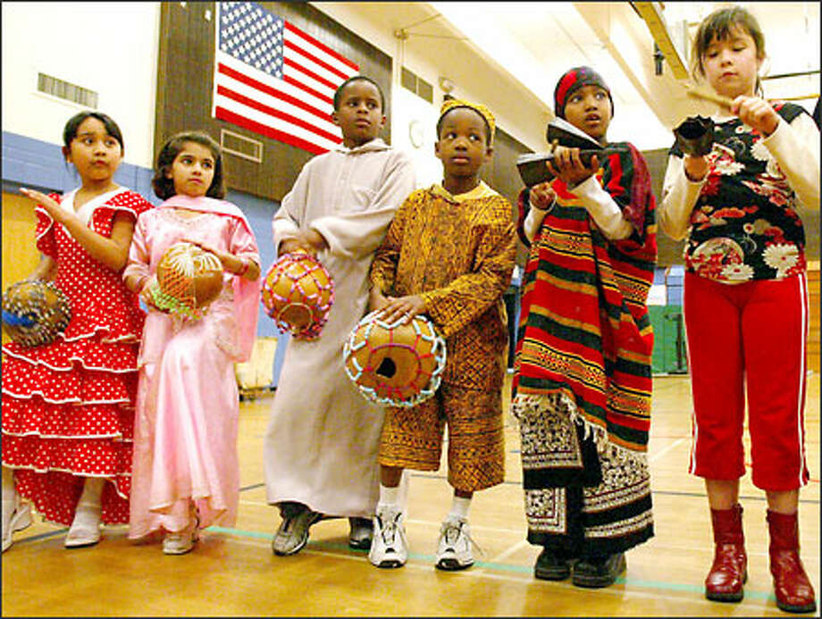 Seattle's Broadview-Thomson Elementary School sponsored a performance by Adefua African Music and Dance Company Wednesday. At the conclusion of the assembly, students, dressed in traditional clothing of their native countries, played African instruments with Adefua's drummers and dancers. Photo: Paul Joseph Brown, Seattle Post-Intelligencer / Seattle Post-Intelligencer