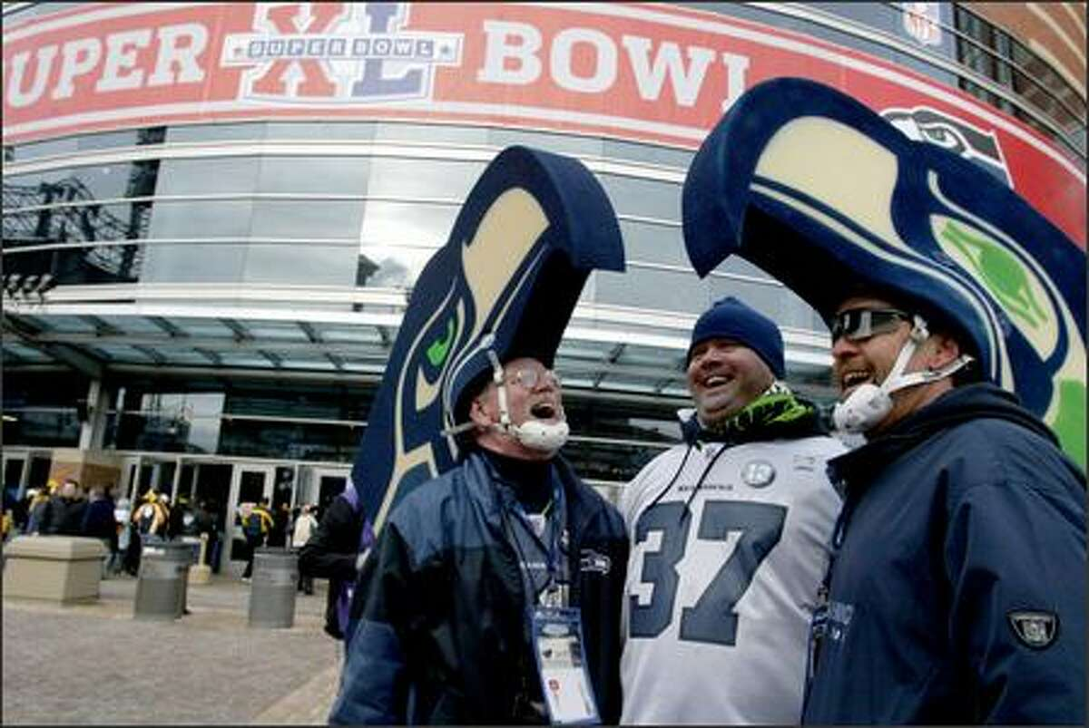 Seahawks fans, from left, Bob McLaughlin, Jared Kline and Jim Kubell show their excitement upon arrival at Ford Field in Detroit for Super Bowl XL.