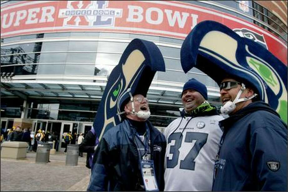 Seahawks fans, from left, Bob McLaughlin, Jared Kline and Jim Kubell show their excitement upon arrival at Ford Field in Detroit for Super Bowl XL. Photo: Joshua Trujillo, Seattlepi.com / seattlepi.com