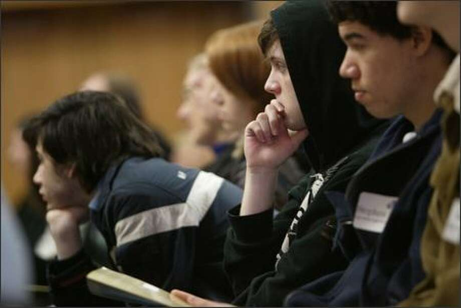 Denny Pritcard, 18, of Scriber Lake High School in Snohomish County listens to speaker Jabez LeBret during a conference at the University of Washington on how to deal with cultural and racial bias among their teenage peers. Photo: Grant M. Haller, Seattle Post-Intelligencer / Seattle Post-Intelligencer