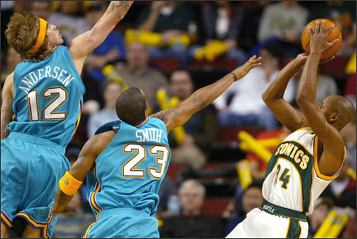 Ray Allen leans back to nail a shot against the Hornets' Chris Andersen and J.R. Smith. Allen scored a game-high 26 points on 11-of-17 shooting as the Sonics won their third consecutive game.