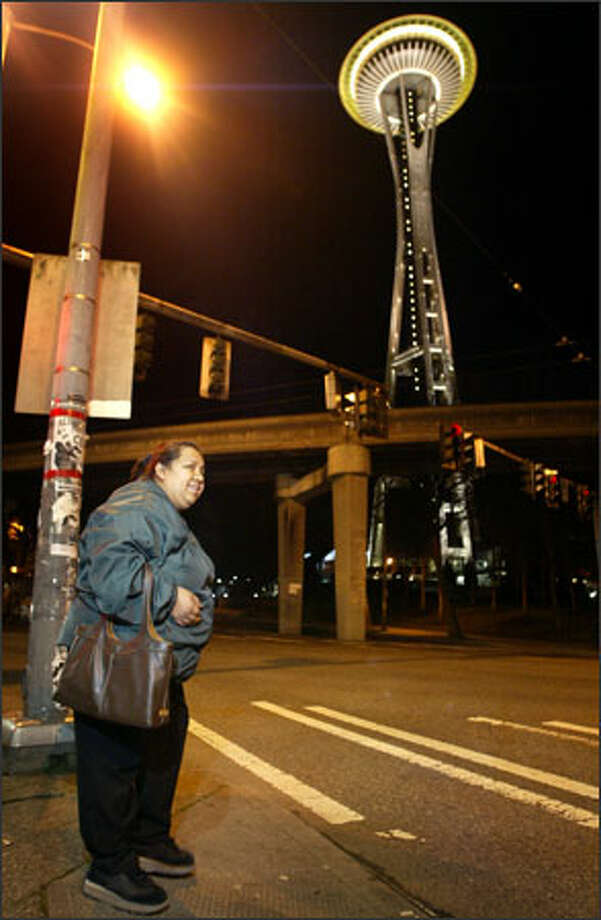 Narciza Pineda, 42, prepares to cross Broad Street on her way to her job as a janitor at the Space Needle, where she earns $10.75 an hour -- more than minimum wage, but barely enough for her family to live on. Photo: Joshua Trujillo, Seattlepi.com / Seattle Post-Intelligencer