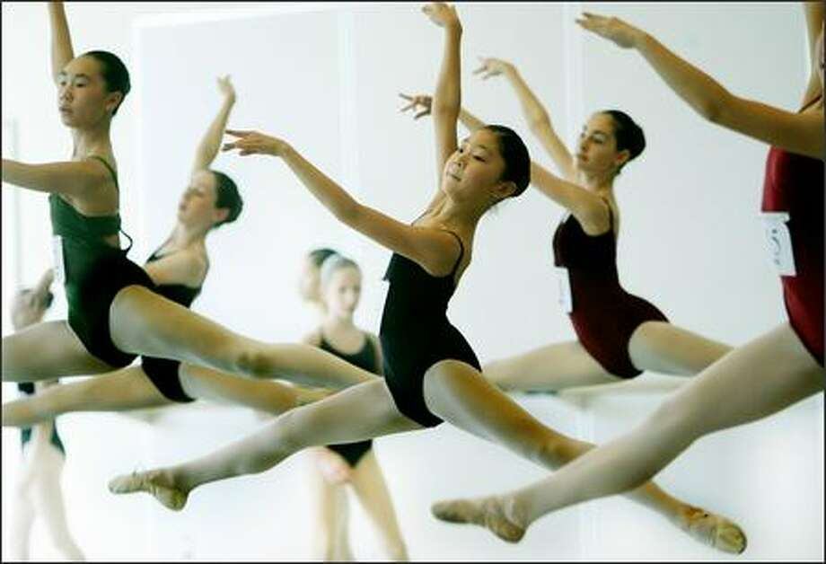 Twelve-year-old Rina Shimizu, center, was among 25 12- and 13-year-old girls who auditioned Sunday at Pacific Northwest Ballet to attend a five-week summer program the School of American Ballet in New York City. According to a news release from The School of American Ballet, only 200 of more than 2,000 aspiring ballet dancers who audition during the 25-city tour will attend the program. The school is the premier ballet academy in the United States and trains more students who become professional ballet dancers than any other American school. Photo: Dan DeLong, Seattle Post-Intelligencer / Seattle Post-Intelligencer