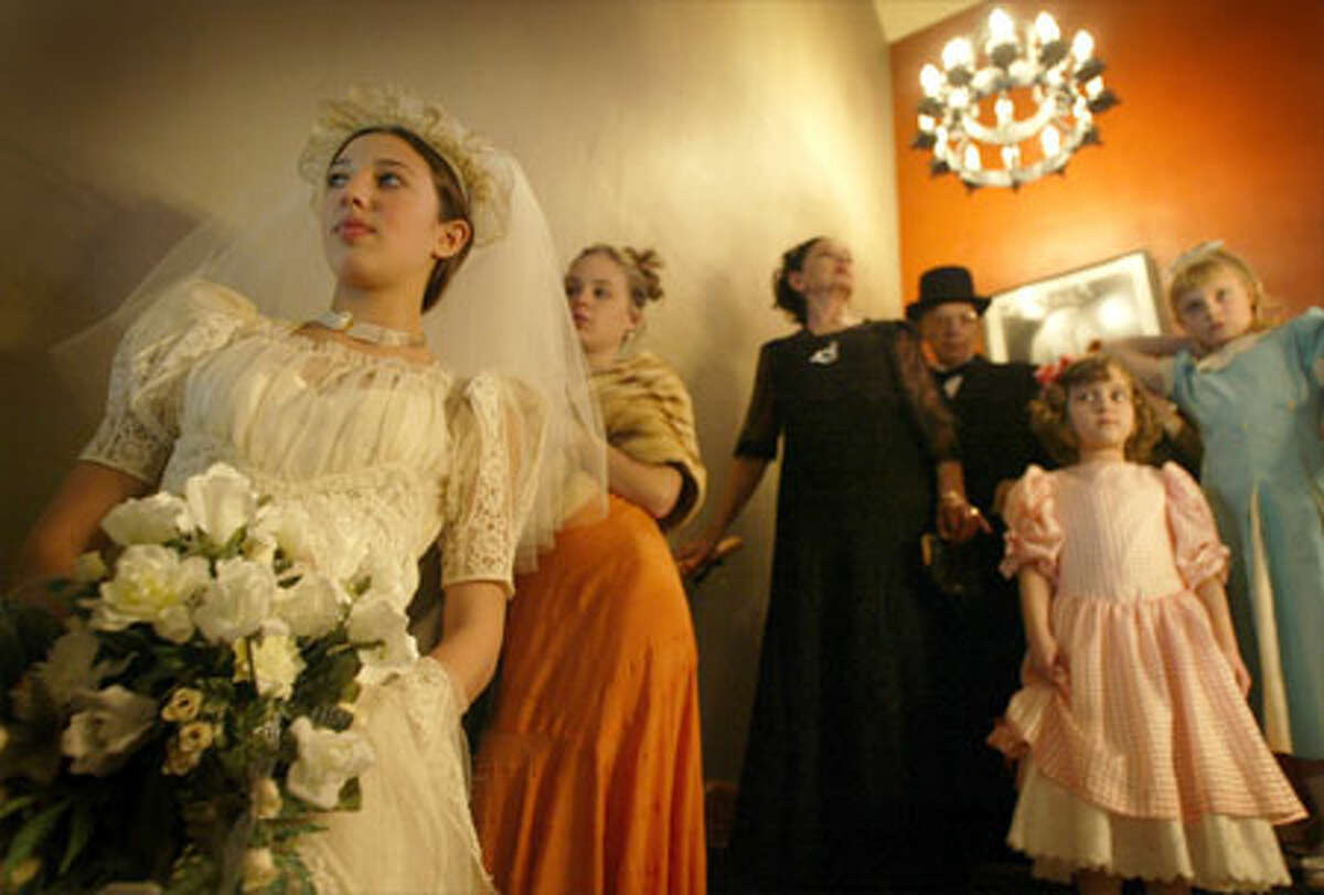 Arielle Weinstein, 13, waits her turn to show off the wedding dress she wore during a vintage fashion show at Inglewood Golf Club in Kenmore Friday. The event was a fund-raiser for the Northshore Performing Arts Center Foundation, which hopes to open a $2.5 million performing arts theater in January 2006.