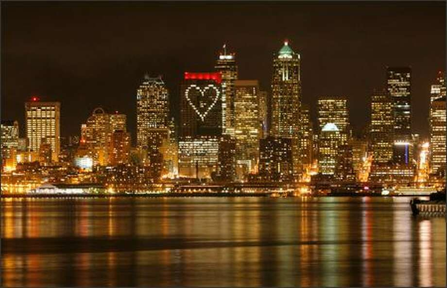 Washington Mutual proved the night of Feb. 13 that Seattle has heart with a big valentine to the city on the west side of the WaMu Center downtown. The company created the 180-foot illuminated heart by having employees close window blinds in three parts of the building and open select ones in the form of a heart. Photo: Gilbert W. Arias, Seattle Post-Intelligencer / Seattle Post-Intelligencer