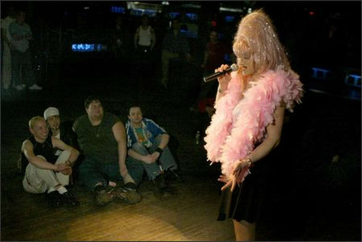 Mark Finley performs to a small crowd at Neighbours Disco, where he's performed for the past six years. In that time, Finley has gone from having five nights a week at three clubs, to just his one night at Neighbours.