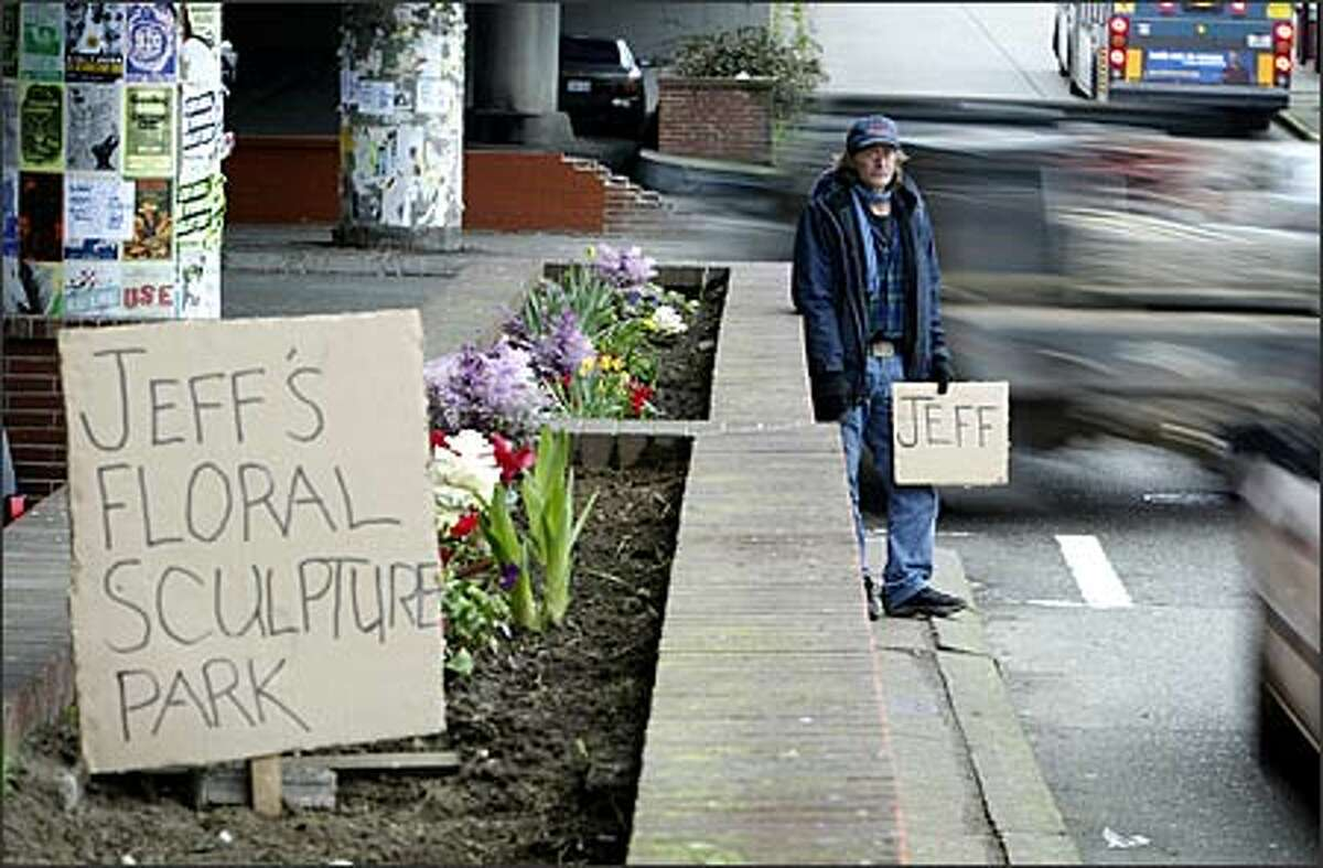 On most days, Jeff Alexander can be found panhandling next to the Ballard Bridge, while his wife, who has epilepsy, rests in their truck under the bridge. On a good day he said he can make around $5 an hour. At night, moving from place to place, the homeless couple use the truck to sleep in. Alexander, 53, an unemployed commercial fisherman, said he loves to garden, so about two months ago he started cultivating the old brick planters that line the street along 15th Avenue Northwest at Northwest Leary Way.