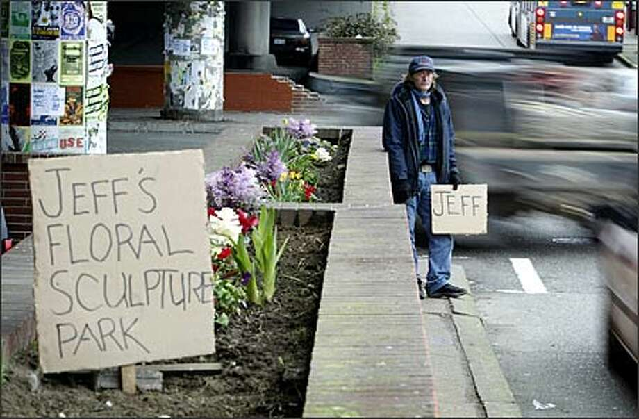 On most days, Jeff Alexander can be found panhandling next to the Ballard Bridge, while his wife, who has epilepsy, rests in their truck under the bridge. On a good day he said he can make around $5 an hour. At night, moving from place to place, the homeless couple use the truck to sleep in. Alexander, 53, an unemployed commercial fisherman, said he loves to garden, so about two months ago he started cultivating the old brick planters that line the street along 15th Avenue Northwest at Northwest Leary Way. Photo: Gilbert W. Arias, Seattle Post-Intelligencer / Seattle Post-Intelligencer