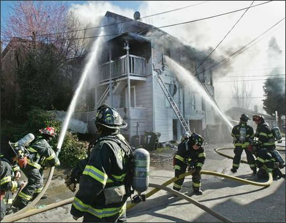 Seattle firefighters extinguish a fire that gutted a small apartment building in Seattle's Eastlake neighborhood.