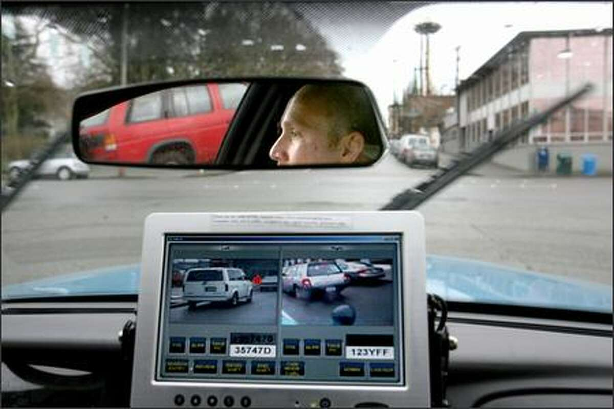 Some new high-tech, police tools in the fight against auto theft include this gadget, which can read license plates at incredible speed from a passing patrol car. Seattle police Detective Manuel Quinonez is driving a patrol car Thursday that is being used as a pilot for this device.