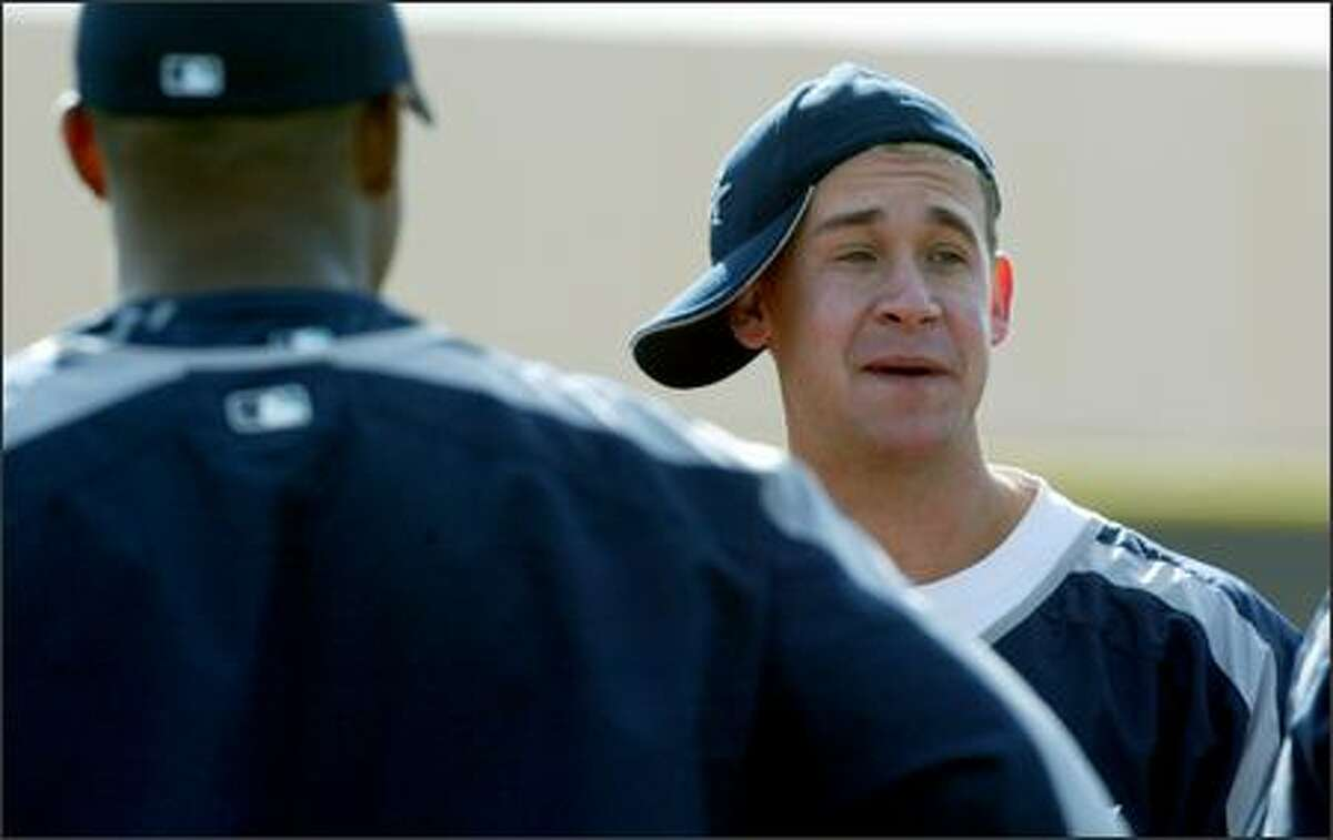 Seattle Mariners second baseman Bret Boone goofs around during a break at spring training in Peoria, Ariz.