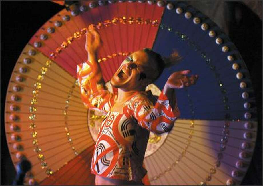 """""""Girly Man Extraordinaire ULTRA!"""" performs during Big Wheel Bingo at the Can Can Kitchen and Cabaret. Truly, this is not your father's (or grandmother's) bingo. Photo: Mike Urban, Seattle Post-Intelligencer / Seattle Post-Intelligencer"""