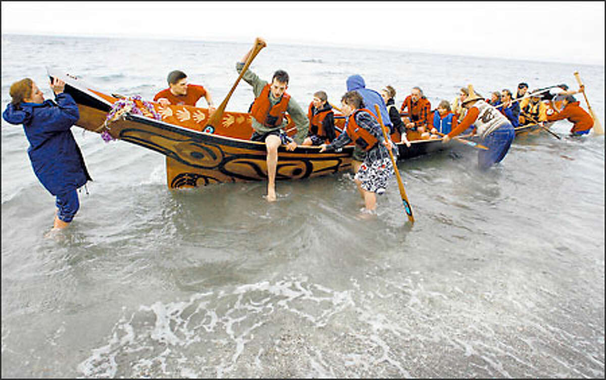 """Three years after starting the project, students of Alternative School No. 1 near Northgate and volunteers took their first paddle in the """"Ocean Spirit"""" canoe they carved from a 750-year-old red cedar log. The 40-foot canoe, which will become a gift to the Haida Nation in Alaska, will be on display at the Seattle School Board Building until mid-March."""