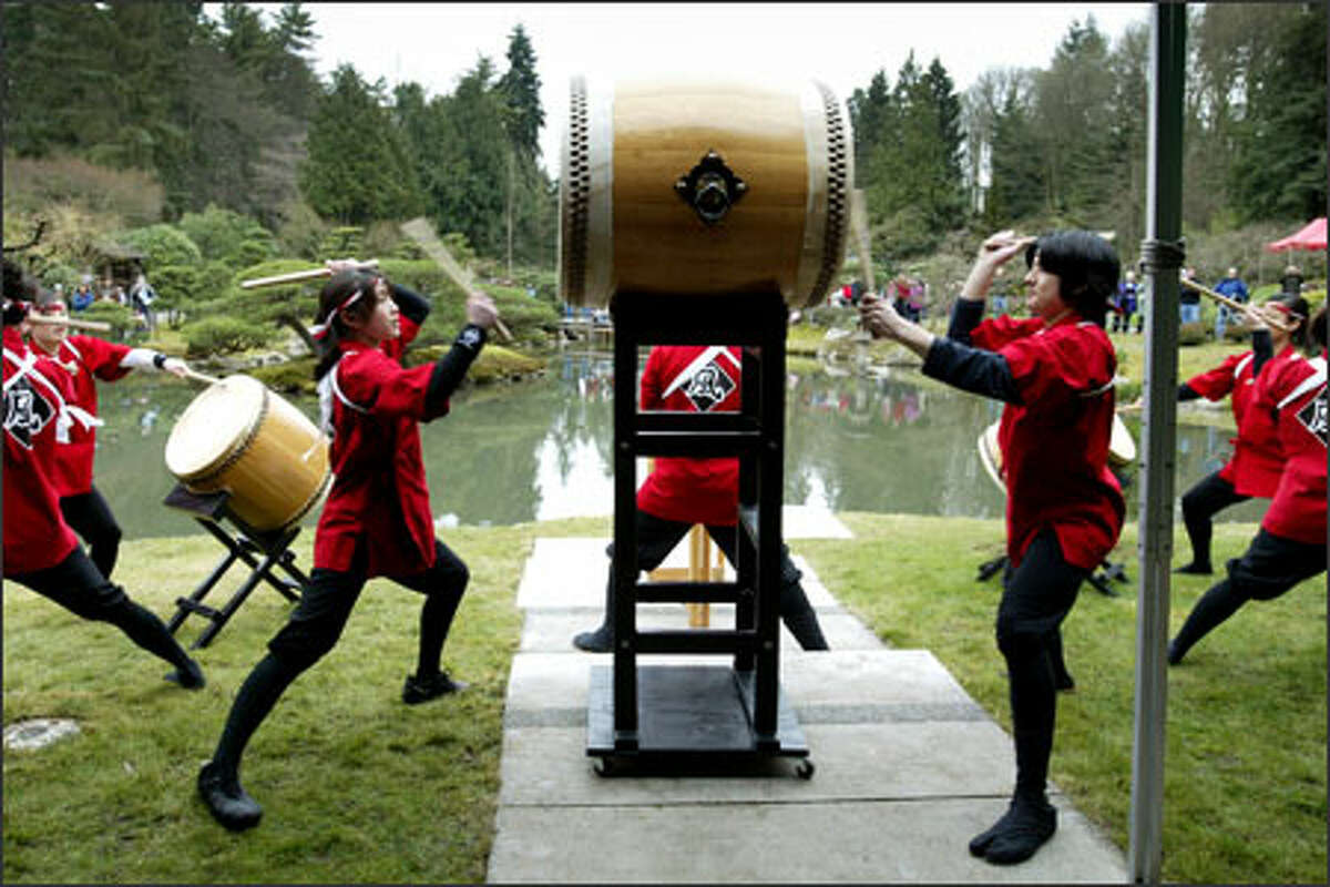 Robin Momii, 15, left, and Griffin Joko-Fujimoto, 16, set the beat on an odaiko Sunday at the Seattle Japanese Garden opening ceremony. They performed with others in the youth taiko drum group Kaze Daiko.