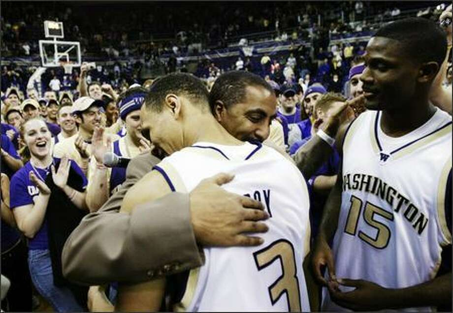 Brandon Roy embraces Huskies coach Lorenzo Romar after the senior's final game at Edmundson Pavilion. Bobby Jones, Romar's first UW recruit and another of the Huskies' five seniors, waits his turn. Photo: Dan DeLong, Seattle Post-Intelligencer / Seattle Post-Intelligencer