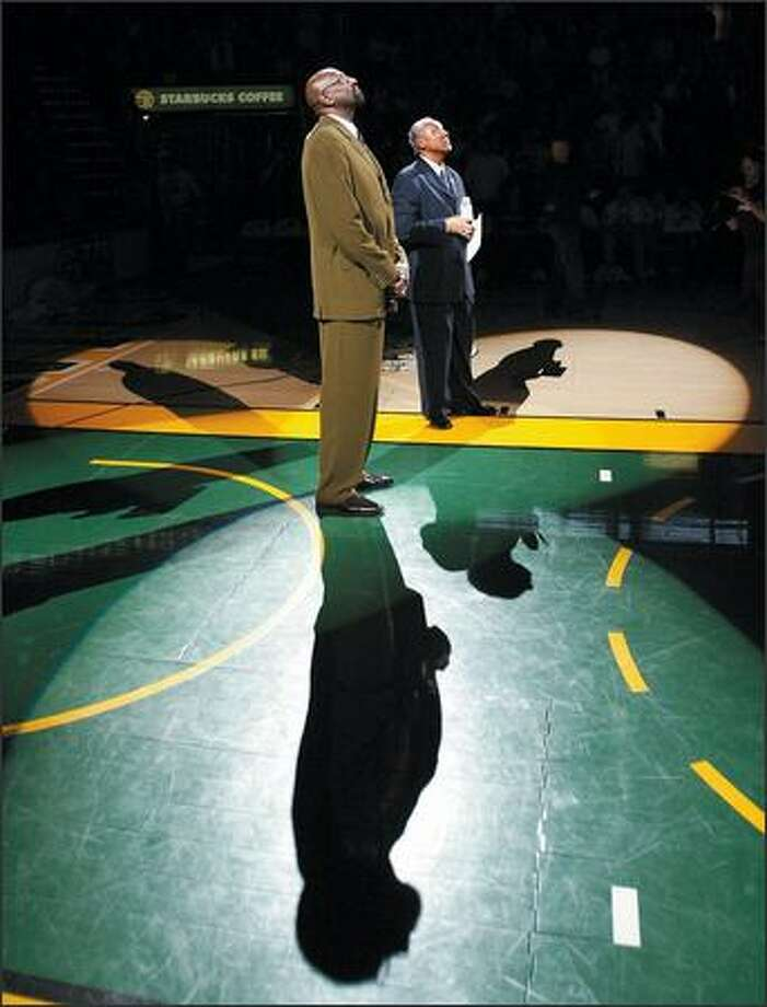 Spencer Haywood watches a video tribute while being honored at halftime as the Seattle SuperSonics play the Portland Trail Blazers at KeyArena. Photo: Scott Eklund, Seattle Post-Intelligencer / Seattle Post-Intelligencer