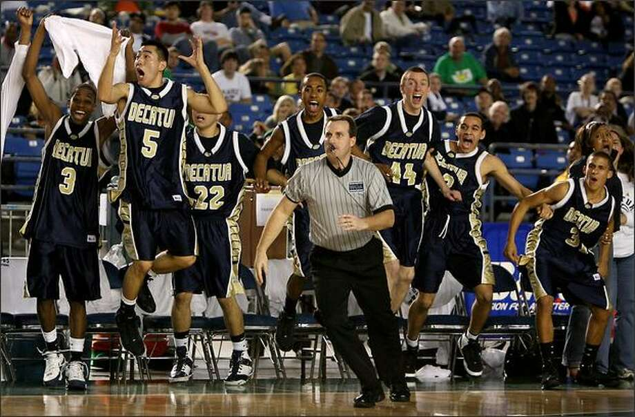 The Decatur bench erupts after holding on for the 57-55 win with 1.3 seconds left, Shadle Park wasn't able to score as Decatur High School beat Shadle Park High School in the quarterfinals of the WIAA Boys' 4A state championship at the Tacoma Dome in Tacoma, Wash. Photo: Scott Eklund, Seattle Post-Intelligencer / Seattle Post-Intelligencer