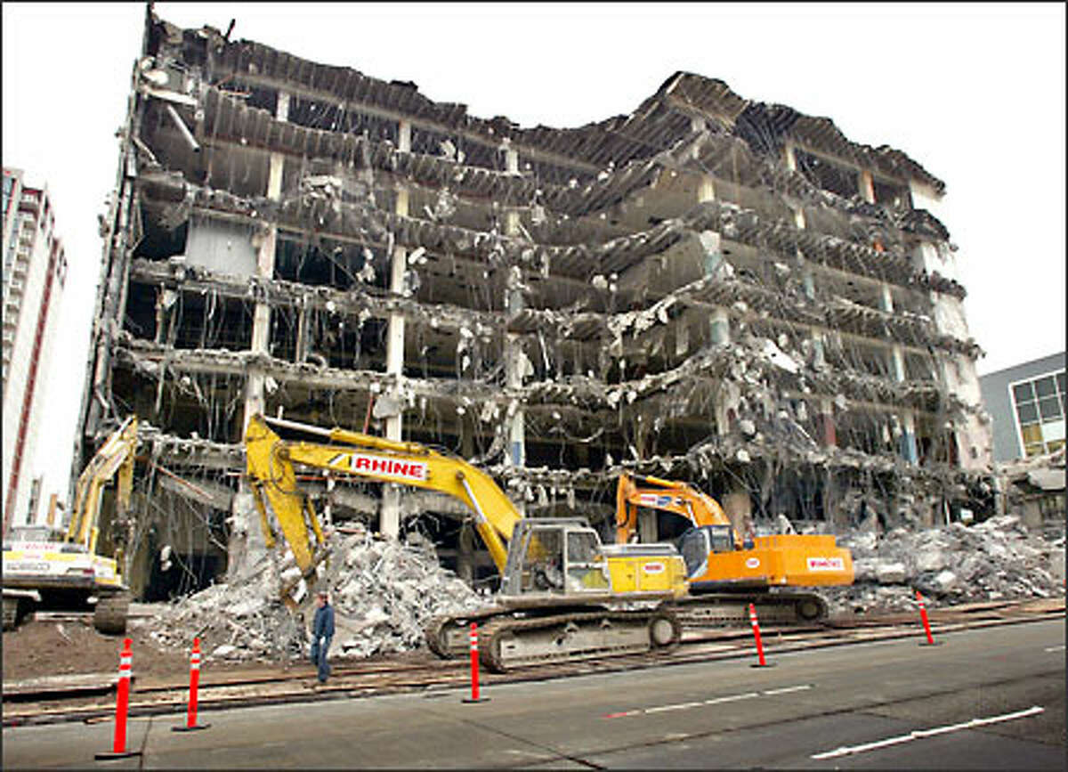 Demolition moves ahead Sunday on the Arcade Building, along Union Street between First and Second avenues in Seattle. The demolition will make room to expand the Seattle Art Museum and for Washington Mutual's new headquarters. The building dates back to the early 1900s. It was the original location of the Rhodes Department Store.