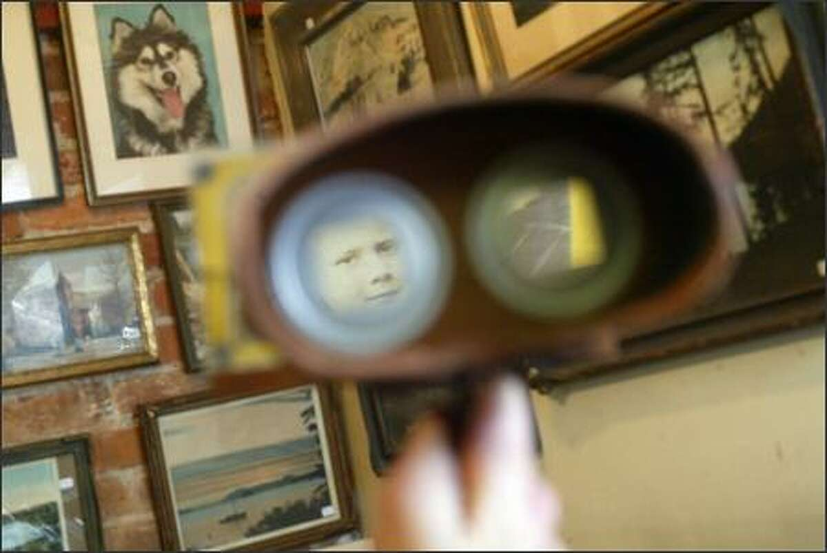 A view through one lens of a stereo viewer shows a child in 3-D at Fairlook Antiques, a store in Pioneer Square, which specializes in old photographs, postcards and historical paper. Most photographs in the store are from the 1890's to 1930's.