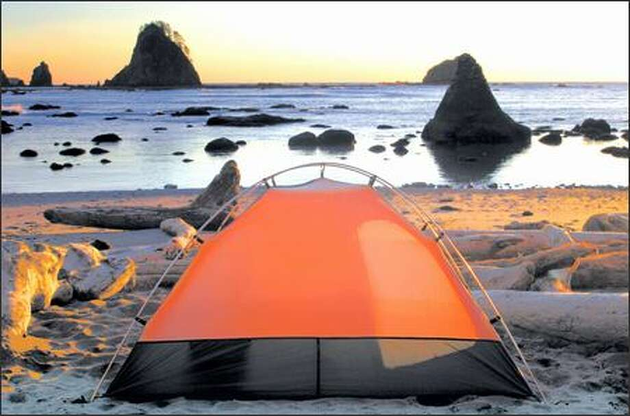 Winter backpacking doesn't get any better than this. A campsite on a sandy beach near the Chilean Memorial offers a widescreen view of a lovely Pacific Ocean sunset. Photo: Joshua Trujillo, Seattlepi.com / seattlepi.com