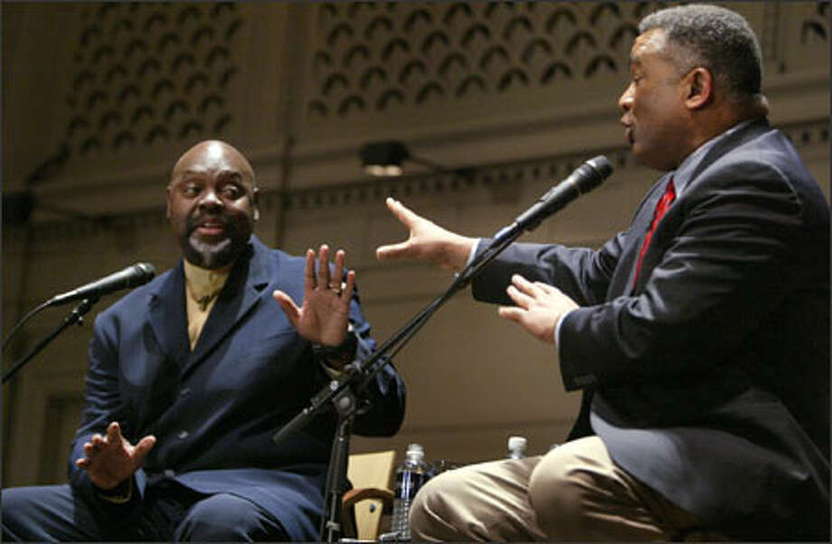 "The Rev. Ken Hutcherson, left, pastor at Antioch Bible Church in Redmond, and King County Executive Ron Sims engage in a lively debate Thursday night at Town Hall over gay rights. ""I'm hoping somebody will throw something,"" said one member of the audience. Photo: Joshua Trujillo, Seattlepi.com / Joshua Trujillo / Seattle Post-Intelligencer"