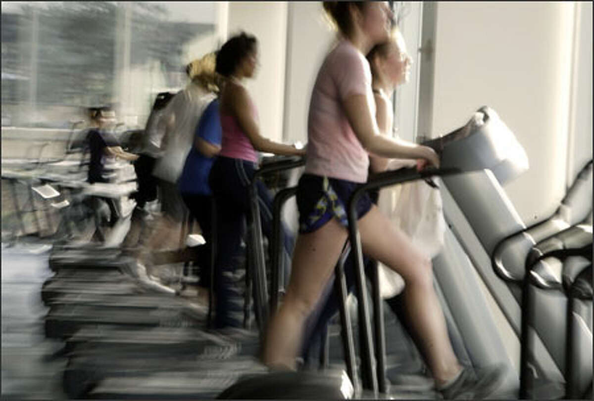 UW students work out in the campus fitness center.