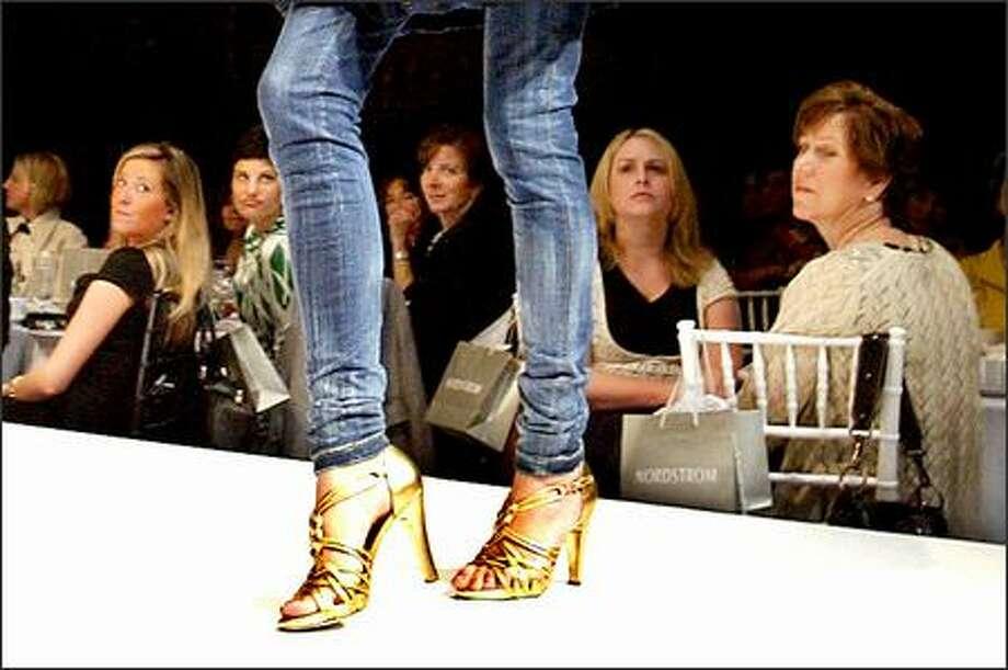 "A model displays stretch denim ""Jai"" skinny pants at the Nordstrom Fashion Ovation show. Photo: Scott Eklund, Seattle Post-Intelligencer / Seattle Post-Intelligencer"