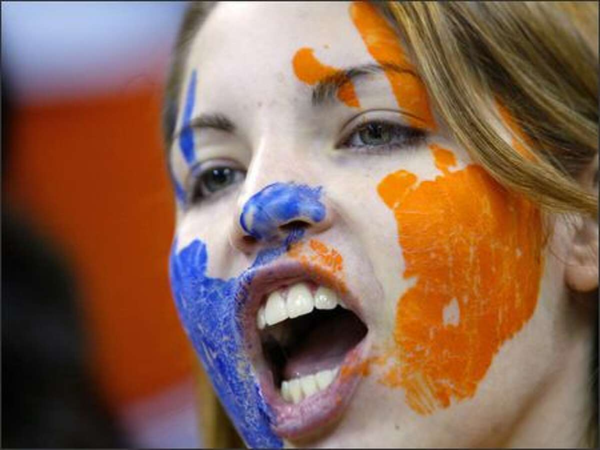 Taylor Smith, 16, sports face paint in the Rainier Beach High School colors while cheering on her team at the WIAA /Dairy Farmers of Washington Championships in Seattle.