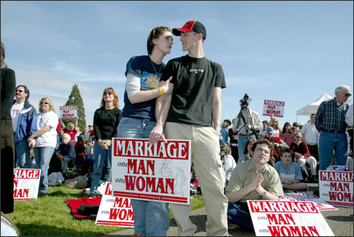Jessica Knox, 18, left, and fiance Tristan Curren, 19, of Port Angeles were among those at the Capitol rallying against same-sex marriage.