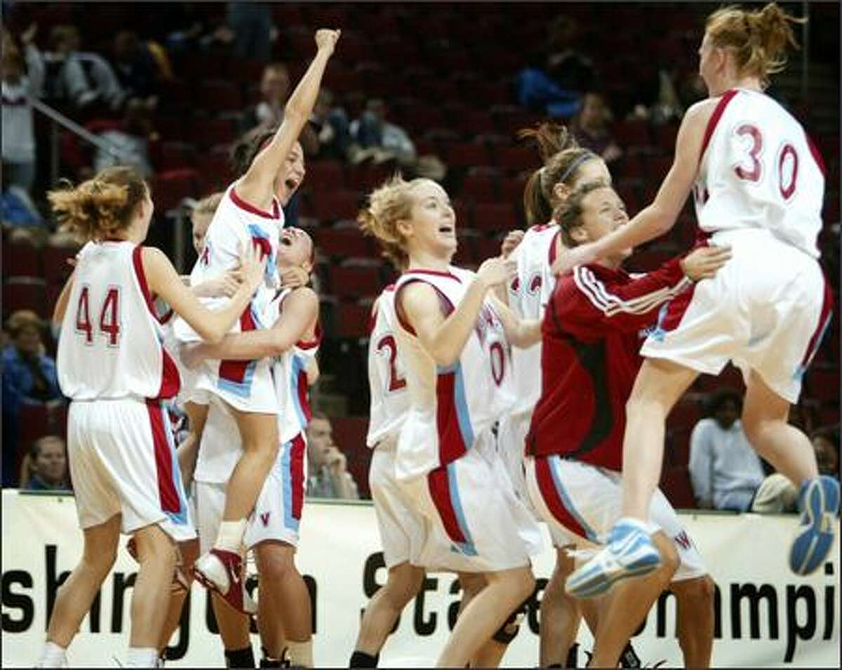 West Valley Rams players celebrate after defeating the White River Hornets in overtime at KeyArena.