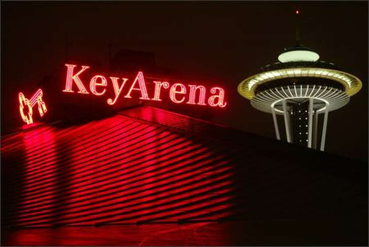 KeyArena and the Space Needle at night.