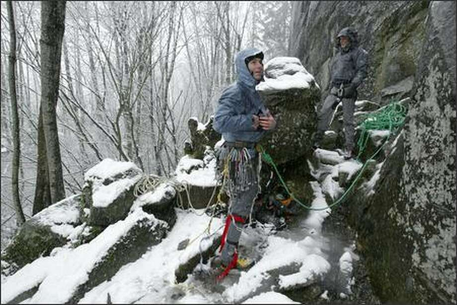 Colin Haley, left, is a 23-year-old University of Washington student who is considered one of the top young mountain climbers in the world.  On this chilly day -- Feb. 28, 2007 -- Haley and friend Rob Smith brave the cold and snowy conditions to climb the Granite Wall outside the town of Index. Photo: Gilbert W. Arias, Seattle Post-Intelligencer / Seattle Post-Intelligencer