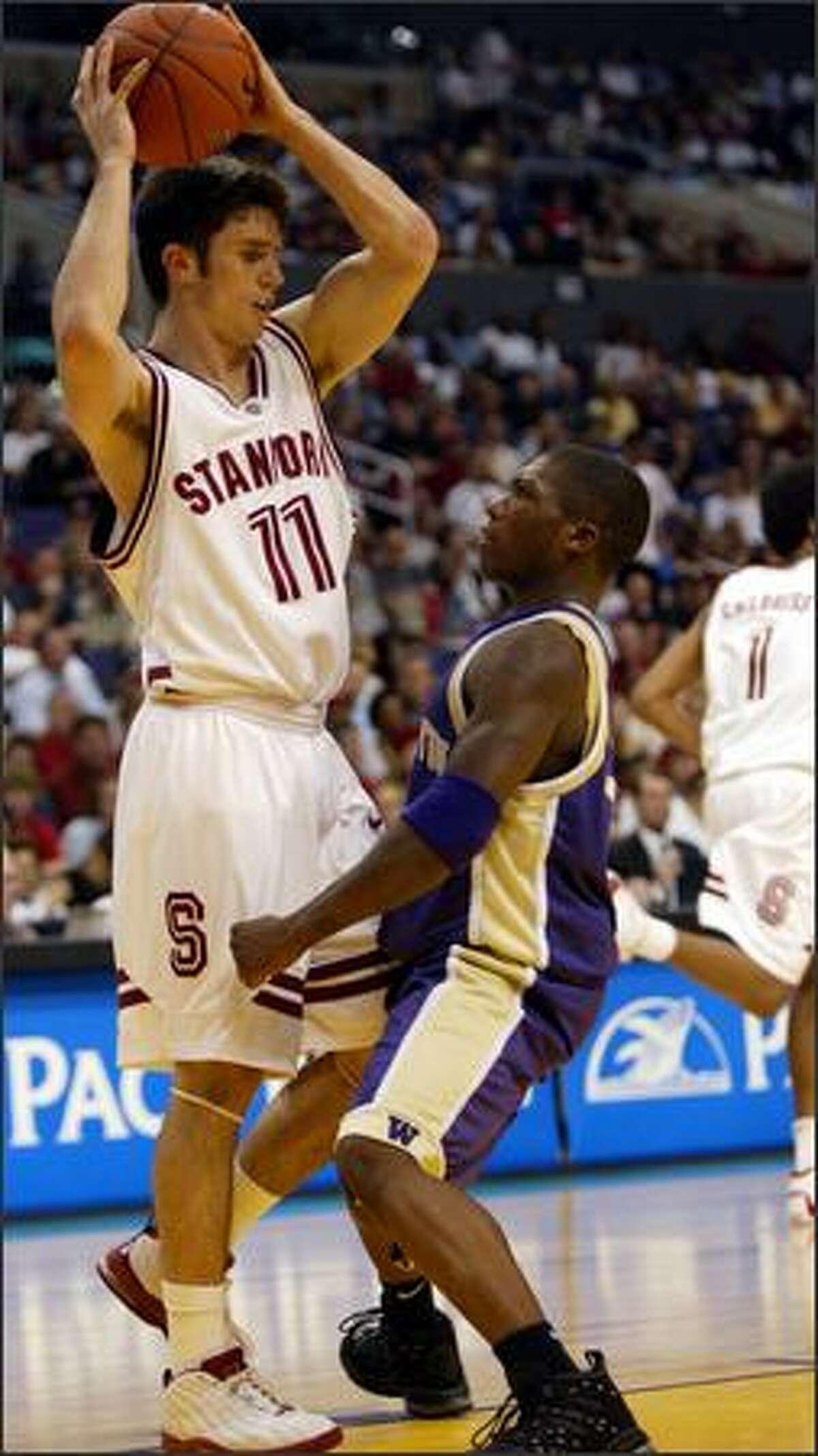UW's Nate Robinson stops Stanford's Chris Hernandez in the first half.