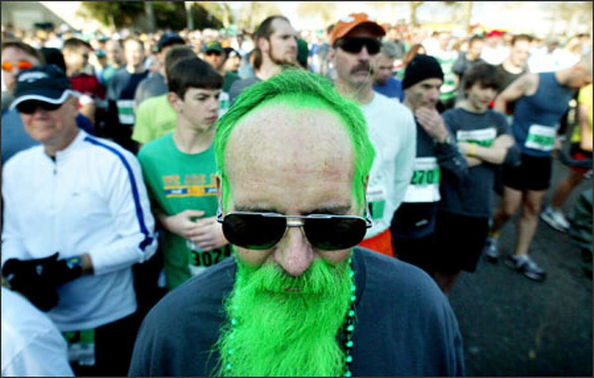 Bill Joyce of Mountlake Terrace sports the spirit and color of the day as he waits on Mercer Street for the start of the annual St. Patrick's Day Dash. The green-coifed Joyce, whose hair was colored by granddaughter Antonia Joyce, was one of 11,750 people who participated in the race Sunday.